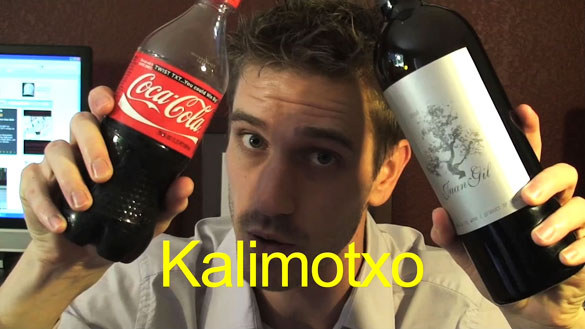 Mike Supple mixing wine and Coca-cola to make a calimocho.