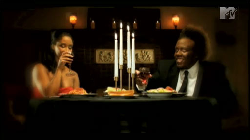 Krizz Kaliko drinking red wine with spaghetti in his video 'Misunderstood'