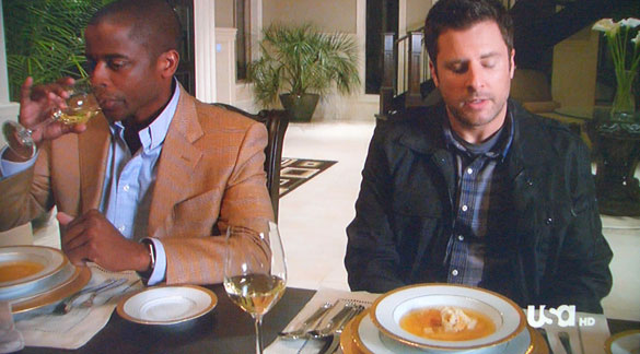 Gus (Dulé Hill) haughtily drinks his white wine while Shawn (James Roday) explains allergies to rich white people.